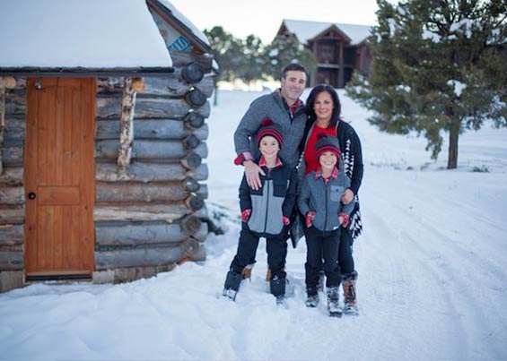 Jeremy Fouts with his family on their ranch in the Colorado Rocky Mountains.